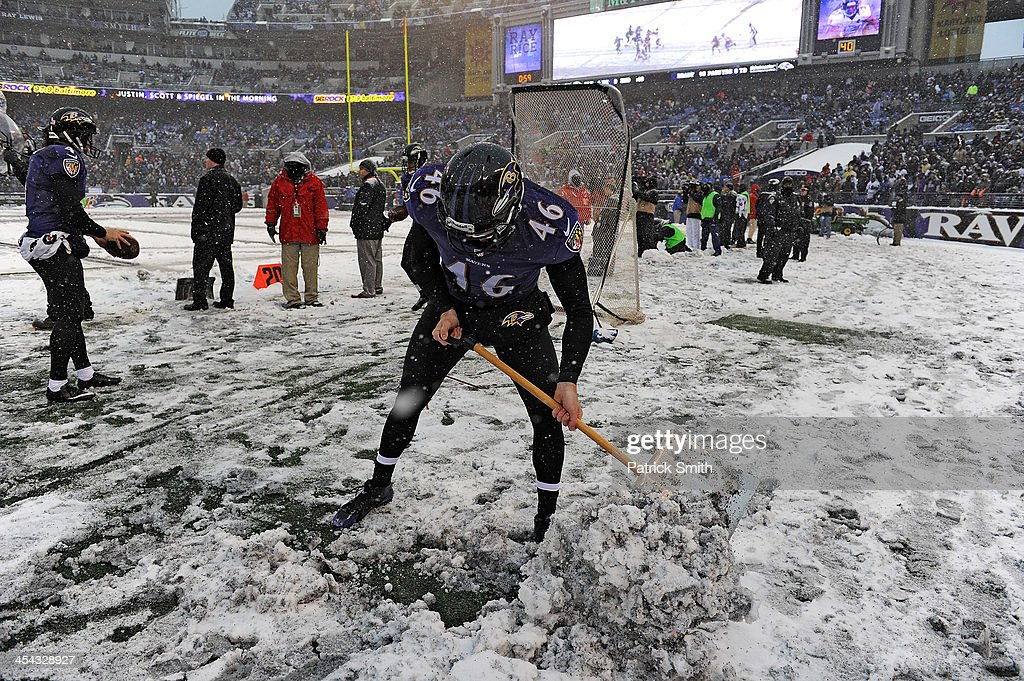 Long snapper Morgan Cox #46 of the Baltimore Ravens tries to clear the sideline during an NFL game against the Minnesota Vikings at M&T Bank Stadium on December 8, 2013 in Baltimore, Maryland. The Baltimore Ravens won, 29-26.