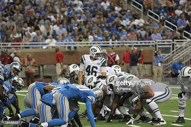 Long Snapper Tanner Purdum of the New York Jets gets set to snap when the Detroit Lions host the New York Jets at Ford Field on August 9 2013 in...