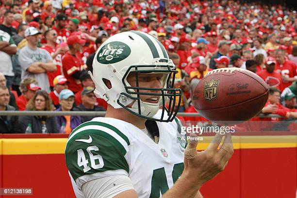 Long Snapper Tanner Purdum of the New York Jets spins a ball on his fingertips during the game against the Kansas City Chiefs on September 25 2016 at...