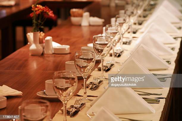 A long table presented in a restaurant