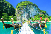 Long Tail Boat ferry at Lagoon Beach with Emerrald Seawater, Green Nature, Hong island Krabi Thailand