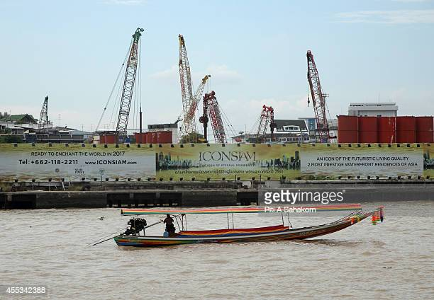 A long tail boat passes by the construction site of ' Icon Siam ' the biggest community mall project in Thailand The THB 50billion Chao Phraya river...