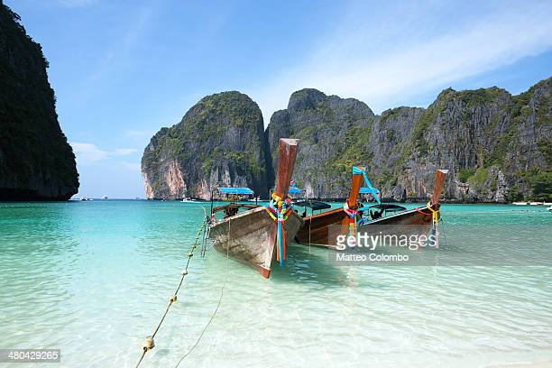 Long tail boats moored on Maya bay beach, Thailand