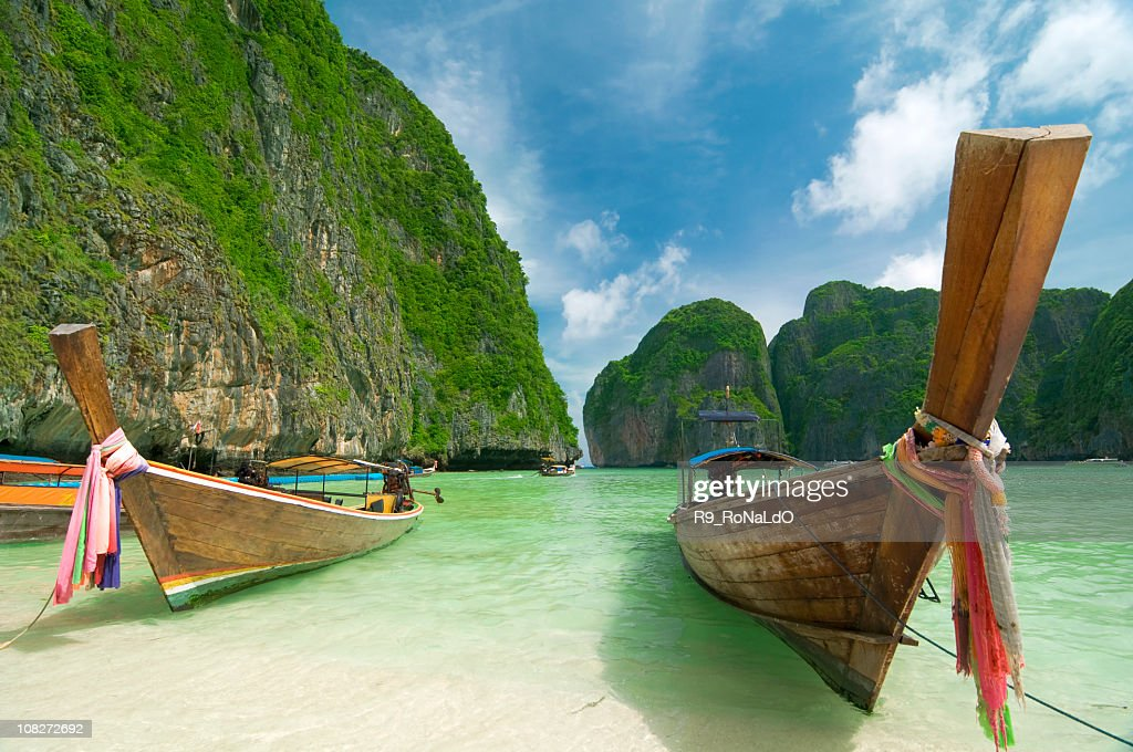 Longtail Boats at the beach on tropical island : Stock Photo