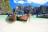 Long tail wooden boats stranded at Maya Bay, Phi Phi Islands, Thailand