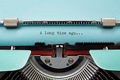 "Vintage Typewriter With Phrase ""A long time ago..."" Typed in Blue Paper"