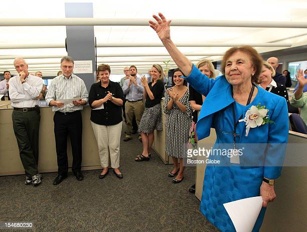 Long time Boston Globe reporter Gloria Negri bids a fond farewell to her fellow colleagues at her retirement sendoff in the Globe editorial newsroom