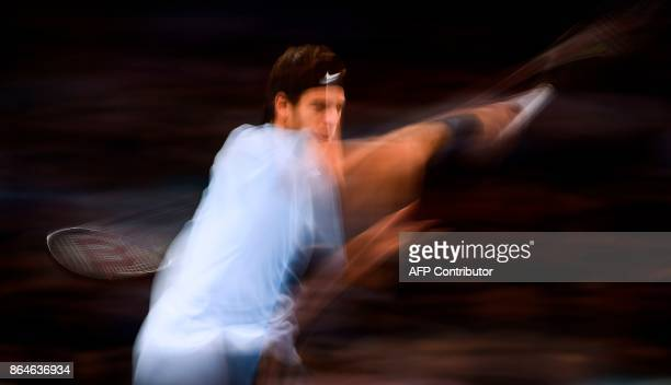 A long time exposed picture shows Argentina's Juan Martin Del Potro returning the ball to Spain's Fernando Verdasco during the semi final match of...