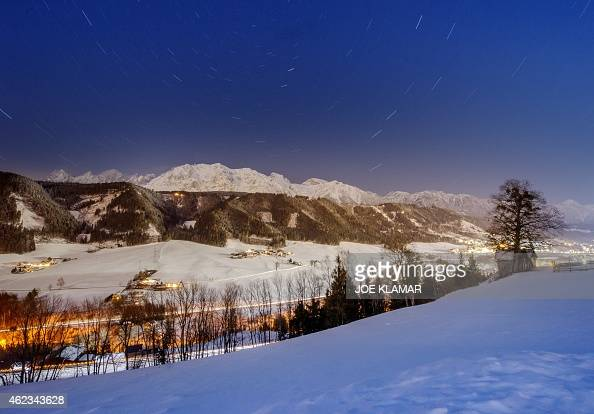 A long time exposed picture shows the Dachstein mountains overlooking Ennstal Valley on the eve of the men's night slalom of the FIS Alpine Skiing...