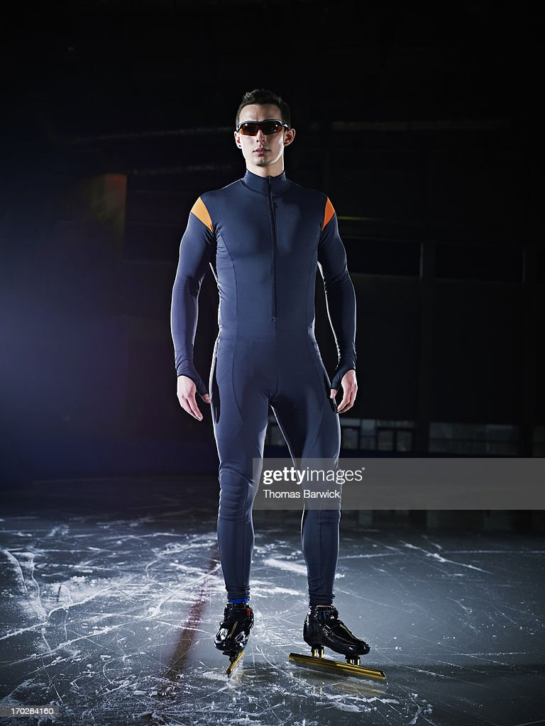 Long track speed skater standing on ice : Stock Photo