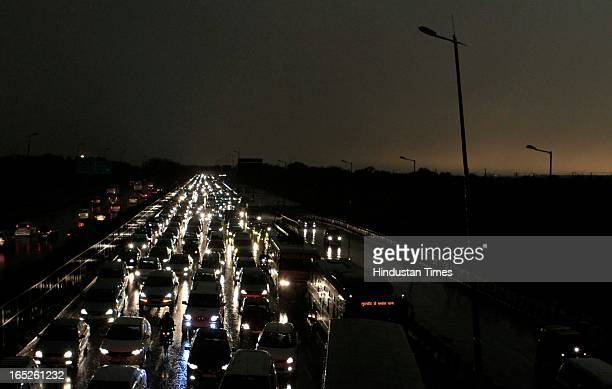 Long traffic jam seen as head lights in dark at 5 15 PM due to sudden rain and storm near IGI Airport on April 2 2013 in New Delhi India Delhi...