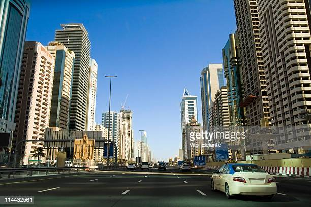 Long view of a road in Dubai showing the buildings