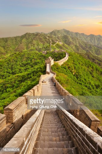 Long view of the Great Wall of China at sunset : Stock Photo