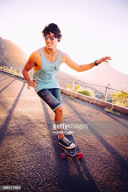 Longboarder skating on sunset street