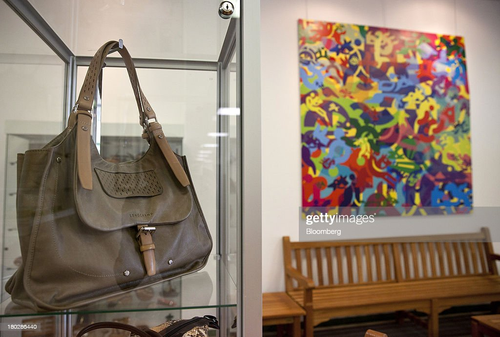 A Longchamp Balzane Roots bag is seen on display in the foyer of the Longchamp SAS workshop in Segre, France, on Monday, Sept. 9, 2013. Longchamp SAS, the French handbag maker, which is known for foldable Le Pliage nylon tote bags, expects sales in China to rise, Chief Executive Officer Jean Cassegrain said. Photographer: Balint Porneczi/Bloomberg via Getty Images