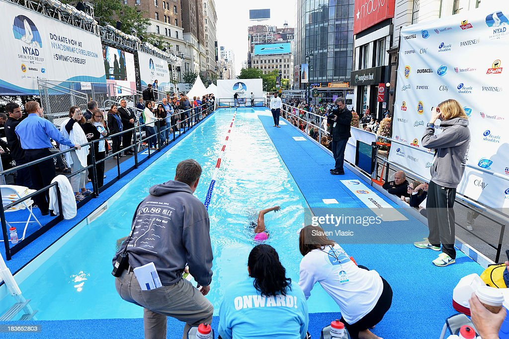 Long-distance swim legend <a gi-track='captionPersonalityLinkClicked' href=/galleries/search?phrase=Diana+Nyad&family=editorial&specificpeople=678501 ng-click='$event.stopPropagation()'>Diana Nyad</a>, fresh off her record-braking swim from Cuba to Florida swims at day 1 of 'Swim For Relief' Benefiting Hurricane Sandy Recovery at Herald Square on October 8, 2013 in New York City.