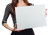 Long-haired beautiful cute brunette woman holding a rectangular blank-poster white canvas with space for text. White background, isolated, studio.unrecognizable