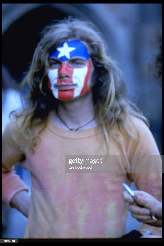 Long-haired man w. face painted red, white and blue at Yale Univ. rally supporting Black Panthers.