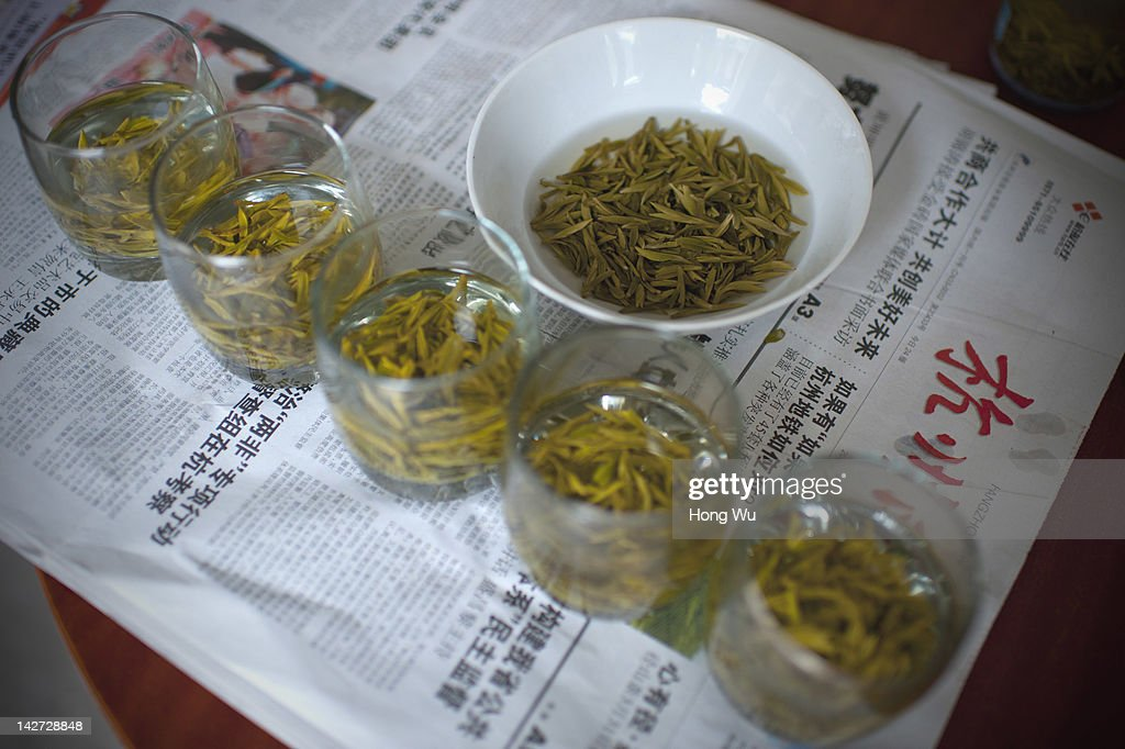 Longjing tea are seen in the cups for taste test and classification at Meijiawu Village on March 29, 2012 in Hangzhou, China. Longjing is a green-tea, often called Dragon Well tea. The tea is typically picked by hand, and is of a high quality, earning the title of China Famous Tea. The Longjing tea begins to pluck before Chinese traditional Qingming Festival, the 15th day from the Spring Equinox or usually occurring around April 5. Many Chinese migrant workers from Jiangsu, Anhui, Jiangxi and other neighboring provices have been employed with 80 RMB yuan(US$12.68) to 120 RMB yuan(US$ 19.03) per day to pluck fresh Longjing tea leaves for villagers in many Longjing tea production villages in the outskirts of Hangzhou. The price of Longjing tea rose in recent years which aims to become to luxury goods. A high-end Longjing tea in Hangzhou sold for 50,000 RMB yuan(US$ 7930) half a kilo in 2012, the price rose 70 times in the last 12 years.