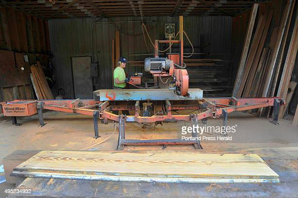 Longleaf lumber mill in Berwick repurposes reclaimed lumber and wood Sawyer Dan Laprise saws boards from reclaimed beams at the lumber yard