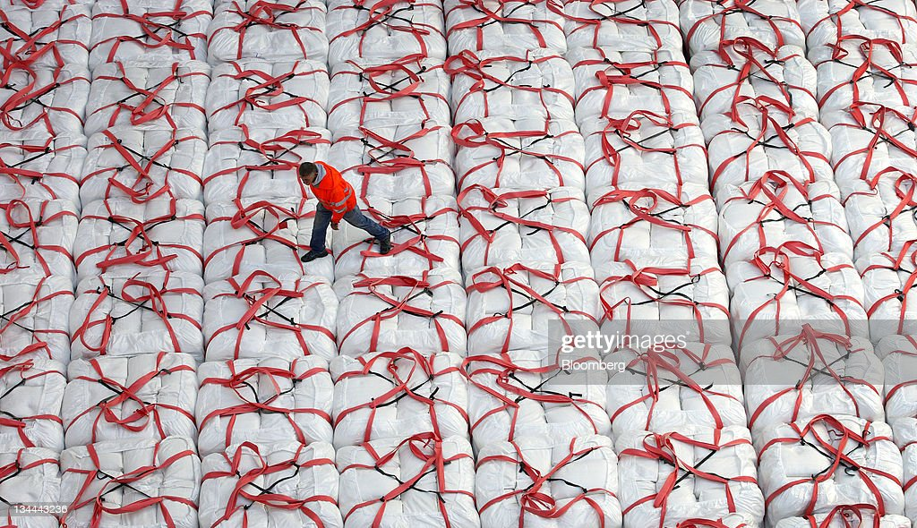 A longshoreman walks on bags of rice in a cargo ship for export to Japan at the Port of West Sacramento in Sacramento, California, U.S., on Friday, Nov. 4, 2011. Rice for November delivery on the Tokyo Grain Exchange settled at 14,400 yen ($184) a bag on Oct. 12, 4 percent cheaper than the price on the Kansai Commodities Exchange in the city of Osaka. Photographer: Ken James/Bloomberg via Getty Images