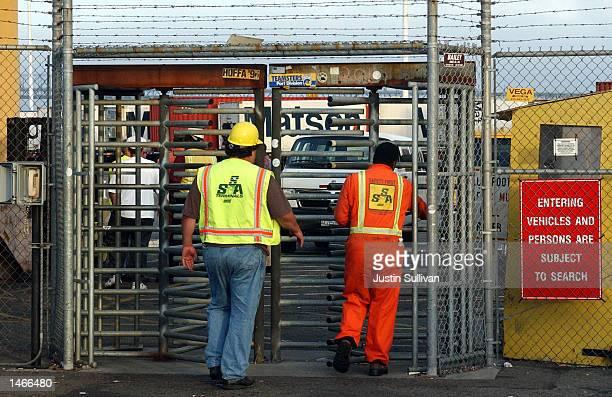 Longshoremen enter the Matson shipping terminal for the morning shift October 9 2002 in Oakland California On October 8 a San Francisco judge ordered...
