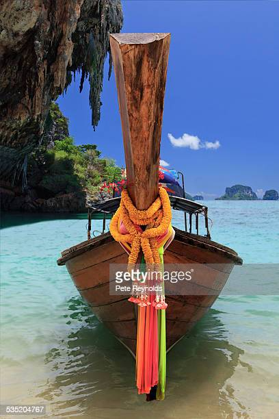 Longtail boat in turquoise waters