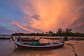Longtail boats at sunset on Koh Lanta, Thailand