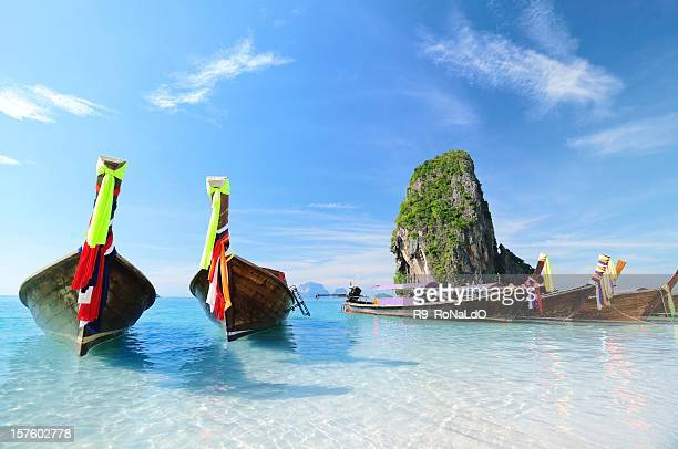 Longtail Boats at the beach on summer paradise tropical island
