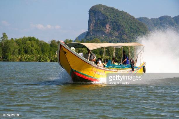 Longtail boats or water taxis as they are sometimes called are a great way of getting around the coast of Phuket and other parts of Thailand The bows...