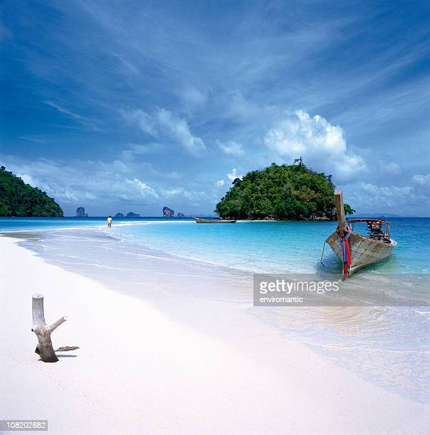 Long-Tailed Boat on White Sand Beach in Thailand.