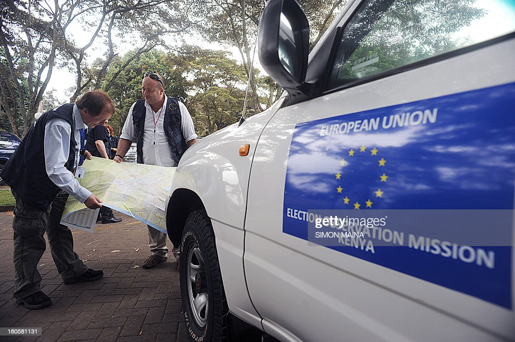Long-Term Observers (LTOs) of the European Union Election Observation Mission take a look at the Kenyan map on February 3, 2013 before they departed from Nairobi to start their observation activities throughout the country before the presidential election scheduled on March 4, 2013. 'Our plan is to send EU observers to every region of Kenya, and I hope that their work will contribute to a peaceful and trans parent election', Dr Gillian McCormack, Deputy Chief Observer of the mission said at the departure. AFP PHOTO/SIMON MAINA