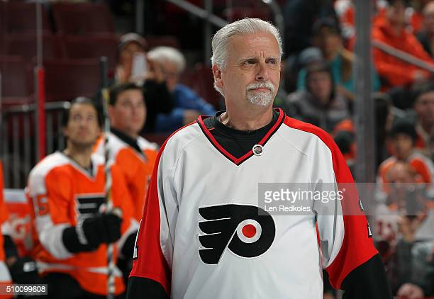 Longtime Flyers season ticket holder Joe Sahina walks to center ice for a pregame ceremony to unveil the new 50th anniversary logo prior to the...