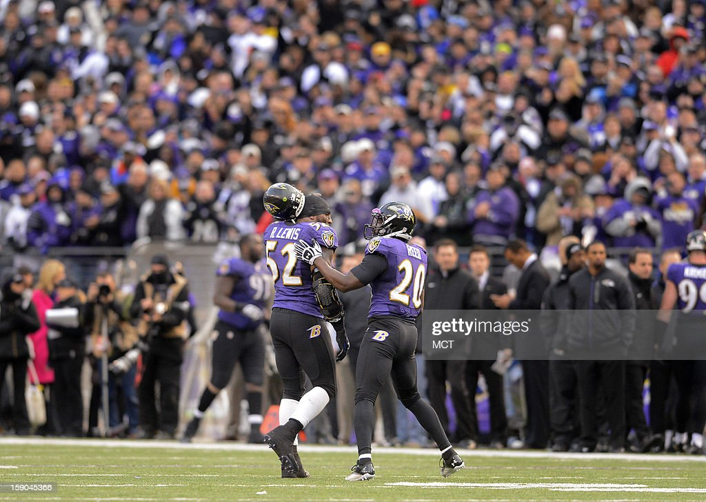 Longtime teammate Baltimore Ravens inside linebacker Ray Lewis and free safety Ed Reed walk off the field together for the last time late the second half of their AFC playoff game in Baltimore, Maryland, on Sunday, January 6, 2013. Lewis announced his retirement early this week.