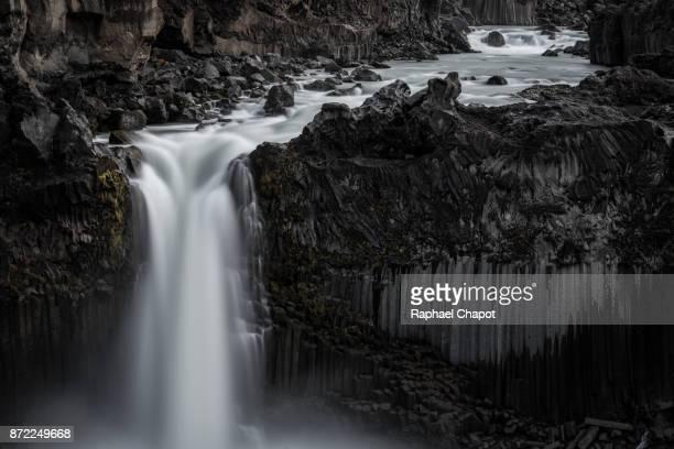 Longue exposure photograph of Aldeyjarfoss waterfall during sunset, Iceland