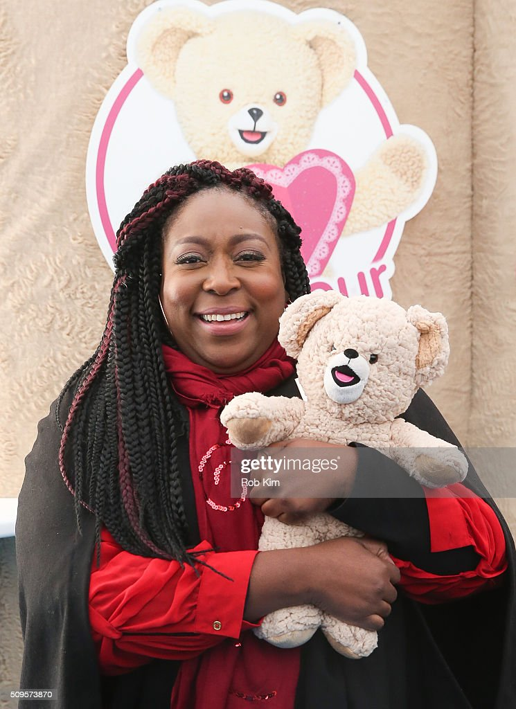 Loni Love hugs a Snuggles bear during #BearYourHeart Event at Flatiron Plaza on February 11, 2016 in New York City.
