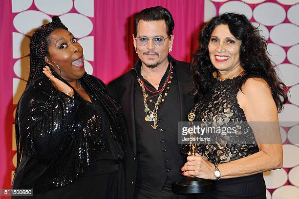 Loni Love Johnny Depp and Yolanda Toussieng on stage at the MakeUp Artists and Hair Stylists Guild Awards at Paramount Studios on February 20 2016 in...
