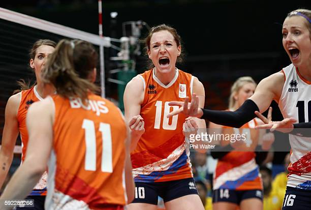 Lonneke Sloetjes Debby StamPilon and Anne Buijs of Netherlands celebrate a point during the Women's Bronze Medal Match between Netherlands and the...