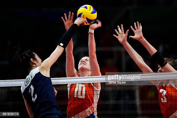 Lonneke Sloetjes of Netherlands and Ting Zhu of China contest the ball during the Women's Volleyball Semifinal match at the Maracanazinho on Day 13...