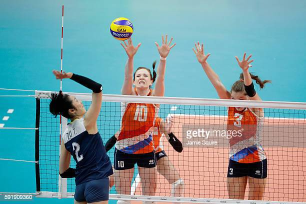 Lonneke Sloetjes of Netherlands and Yvon Belien of Netherlands defend against Ting Zhu of China during the Women's Volleyball Semifinal match at the...