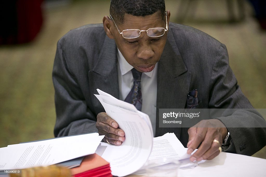 Lonnie Braswell looks over his resume and cover letter at a National Career Fairs job fair in Arlington, Virginia, U.S., on Wednesday, Jan. 30, 2013. The U.S. Labor Department is scheduled to release initial jobless claims data on Jan. 31. Photographer: Andrew Harrer/Bloomberg via Getty Images