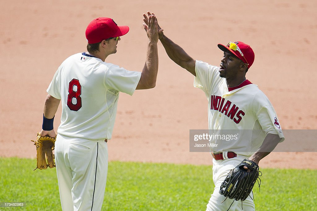 <a gi-track='captionPersonalityLinkClicked' href=/galleries/search?phrase=Lonnie+Chisenhall&family=editorial&specificpeople=6796448 ng-click='$event.stopPropagation()'>Lonnie Chisenhall</a> #8 celebrates with <a gi-track='captionPersonalityLinkClicked' href=/galleries/search?phrase=Michael+Bourn&family=editorial&specificpeople=835742 ng-click='$event.stopPropagation()'>Michael Bourn</a> #24 of the Cleveland Indians after the Indians defeated the Kansas City Royals at Progressive Field on July 14, 2013 in Cleveland, Ohio. The Indians defeated the Royals 6-4.