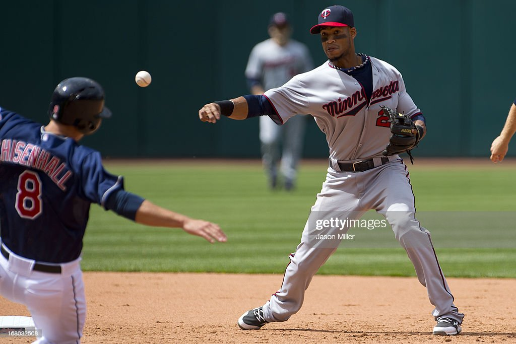 <a gi-track='captionPersonalityLinkClicked' href=/galleries/search?phrase=Lonnie+Chisenhall&family=editorial&specificpeople=6796448 ng-click='$event.stopPropagation()'>Lonnie Chisenhall</a> #8 is out at second as shortstop Pedro Florimon #25 throws to first for the double play to end the sixth inning at Progressive Field on May 4, 2013 in Cleveland, Ohio.