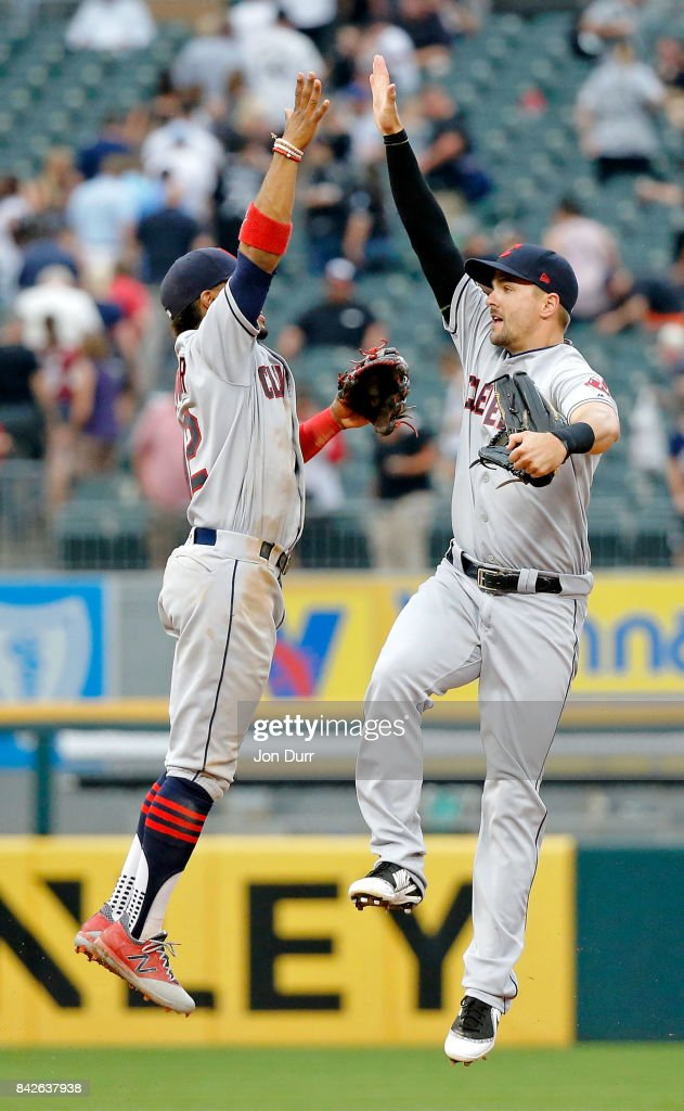 Lonnie Chisenhall #8 of the Cleveland Indians (R) and Francisco Lindor #12 celebrate their win over the Chicago White Sox at Guaranteed Rate Field on September 4, 2017 in Chicago, Illinois. The Cleveland Indians won 5-3.