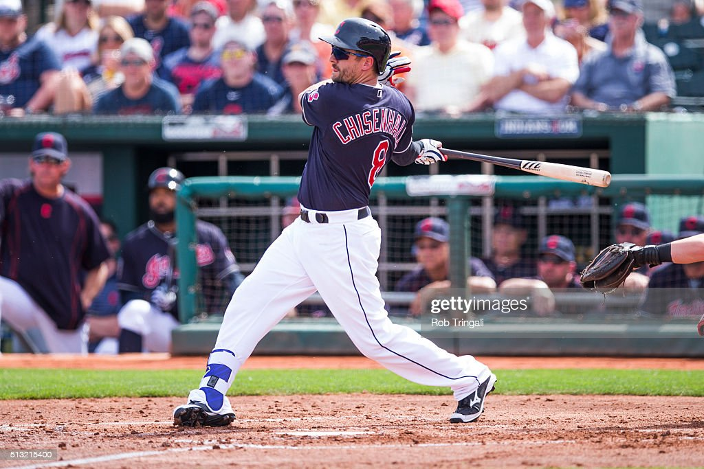 Lonnie Chisenhall of the Cleveland Indians bats during a spring training game against the Cincinnati Reds at Goodyear Ballpark on March 1 2016 in...