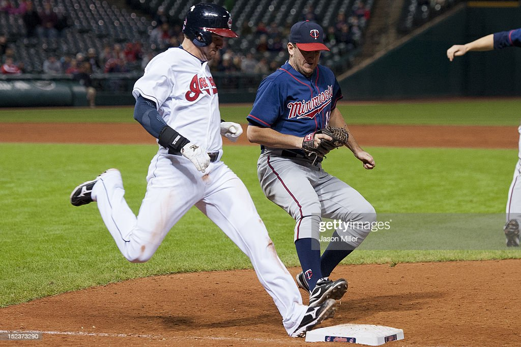 <a gi-track='captionPersonalityLinkClicked' href=/galleries/search?phrase=Lonnie+Chisenhall&family=editorial&specificpeople=6796448 ng-click='$event.stopPropagation()'>Lonnie Chisenhall</a> #8 of the Cleveland Indians beats closing pitcher <a gi-track='captionPersonalityLinkClicked' href=/galleries/search?phrase=Glen+Perkins&family=editorial&specificpeople=835845 ng-click='$event.stopPropagation()'>Glen Perkins</a> #15 of the Minnesota Twins to the bag during the ninth inning at Progressive Field on September 19, 2012 in Cleveland, Ohio. The Twins defeated the Indians 6-4.