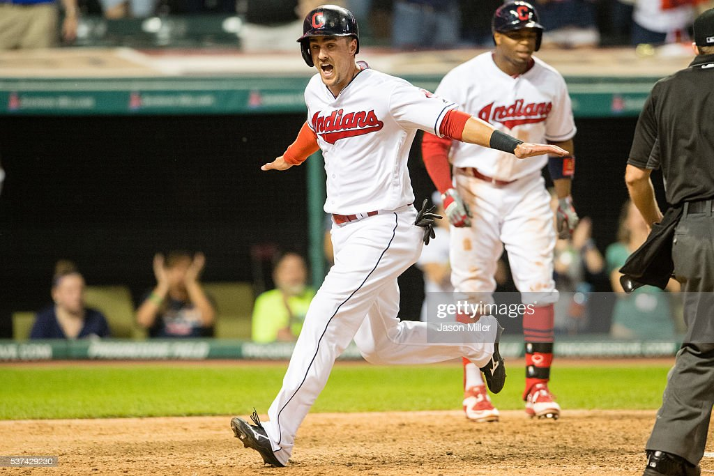 Lonnie Chisenhall of the Cleveland Indians celebrates after scoring off a single by Yan Gomes to win the game in the eleventh inning against the...