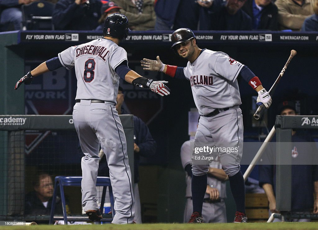 <a gi-track='captionPersonalityLinkClicked' href=/galleries/search?phrase=Lonnie+Chisenhall&family=editorial&specificpeople=6796448 ng-click='$event.stopPropagation()'>Lonnie Chisenhall</a> #8 of the Cleveland Indians celebrates his home run with <a gi-track='captionPersonalityLinkClicked' href=/galleries/search?phrase=Nick+Swisher&family=editorial&specificpeople=206417 ng-click='$event.stopPropagation()'>Nick Swisher</a> #33 in the fifth inning during a game against the Kansas City Royals at Kauffman Stadium on September 16, 2013 in Kansas City, Missouri.