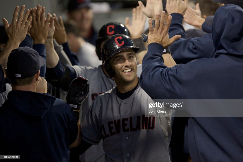 Lonnie Chisenhall #8 of the Cleveland Indians celebrates with teammates after hitting a three-run home run against the Chicago White Sox during the fourth inning of their MLB game at U.S. Cellular Field on September 14, 2013 in Chicago, Illinois.