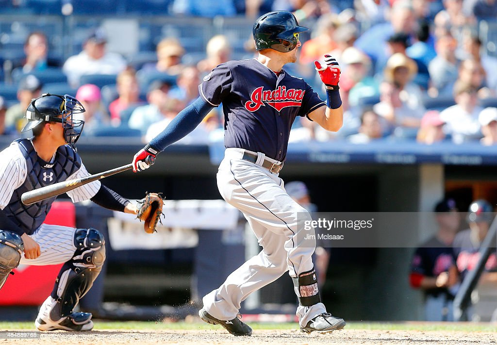 Lonnie Chisenhall of the Cleveland Indians follows through an a RBI base hit to left field in the eighth inning against the New York Yankees at...